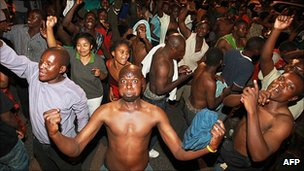 People celebrate in Lusaka early on 23 September 2011