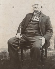 Pte Pearson as an older man wearing his medals