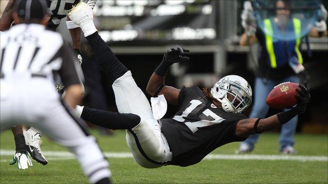 Oakland Raiders' Denarius Moore dives into the end zone