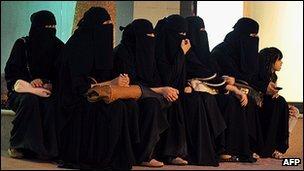 Saudi women wait for their drivers outside a shopping mall in Riyadh
