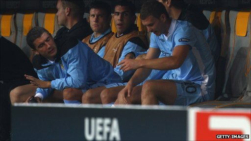 Edin Dzeko (R) of Manchester reacts after his substitution as his team-mates Carlos Tevez (C), James Milner and Aleksandar Kolarov look on during the Champions League group game at Bayern Munich.