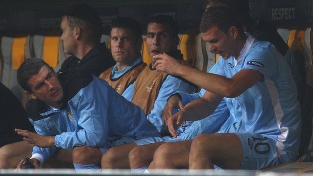 Carlos Tevez on the bench