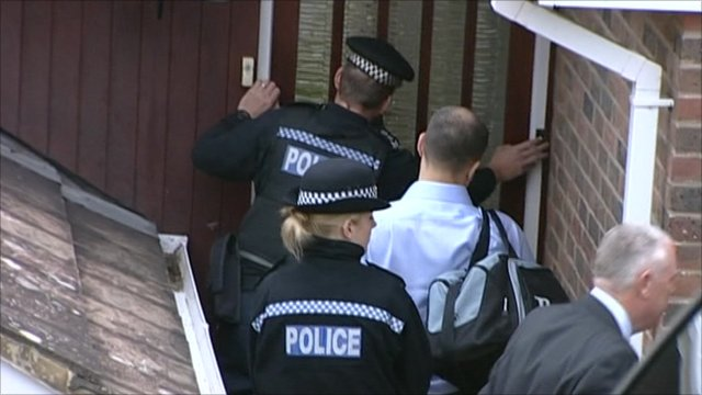 Police during a raid in Brighton