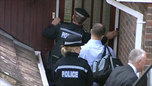 Police during a raid in Brighton