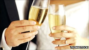 Generic image of newlyweds with champagne