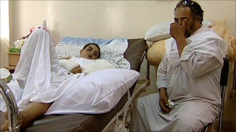 Abdulfatah Hazaz and his father Ibrahim in hospital