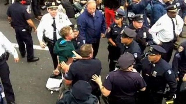 Police arresting protesters on the Brooklyn Bridge
