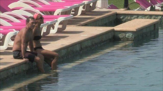 Couple by pool in Lebanese resort