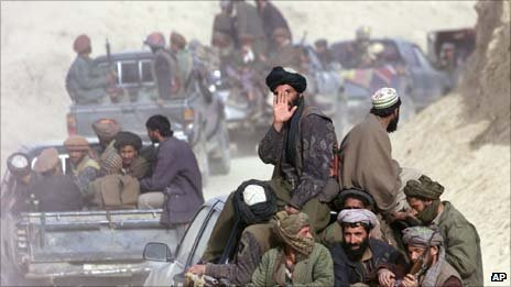 Defecting Taliban fighters drive through the front line in the village of Amirabad, northern Afghanistan, Saturday Nov. 24, 2001. (AP Photo/Dusan Vranic)