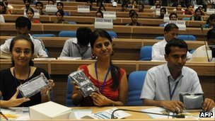 Indian students pose with Aakash computer tablet, 5 October 2011