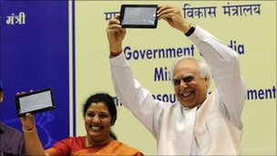 Indian Human Resource Development (HRD) Minister Kapil Sibal (R) and Junior HRD Minister D. Purandeswari (L) pose with Aakash tablet after its launch in Delhi on October 5, 2011.