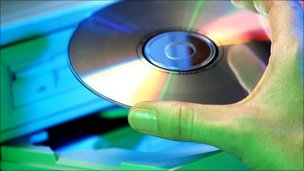 CD being placed in computer