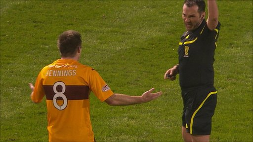 Motherwell's Steve Jennings (8) and referee Stevie O'Reilly
