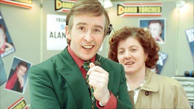 Steve Coogan as Alan Partridge and Felicity Montagu as Lynn