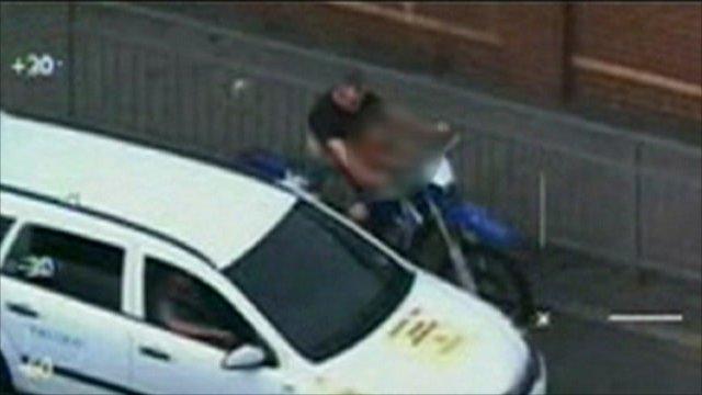 Ryan Ward on his off-road motorbike at traffic lights