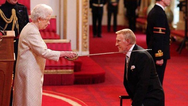 Sir Bruce Forsyth is knighted by Queen Elizabeth II