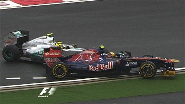 Nico Rosberg collides with Jaime Alguersuari