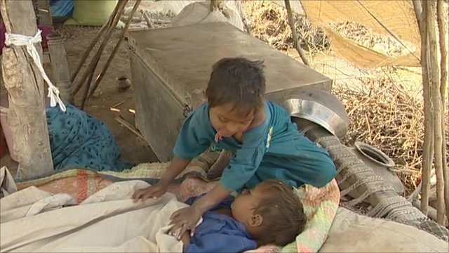 Children in camps after floods
