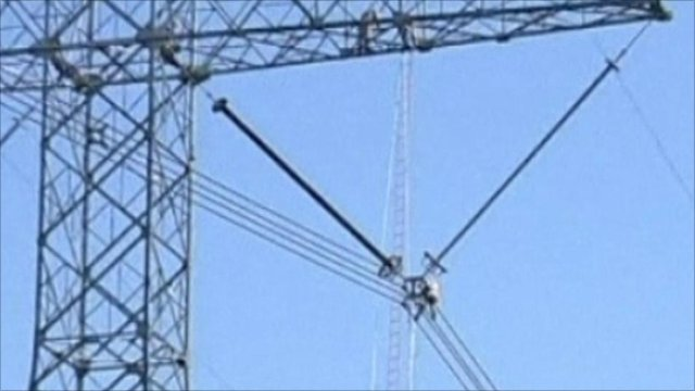 Electrician climbs up high voltage pylon in China