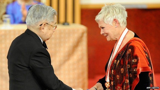 Dame Judi Dench receives her award from Prince Hitachi