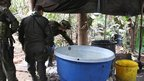 Soldiers investigate a cocaine laboratory in Guacare, Meta province, Colombia