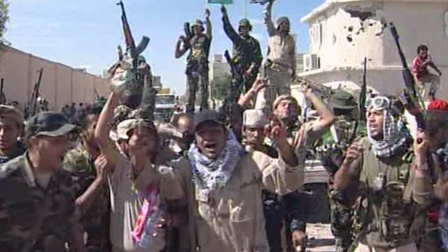 NTC forces 'capture' last Gaddafi stronghold