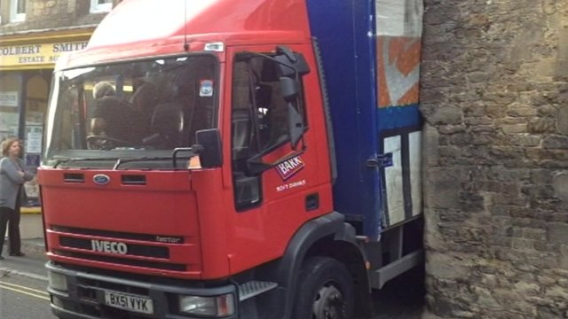 Lorry wedged stuck in street