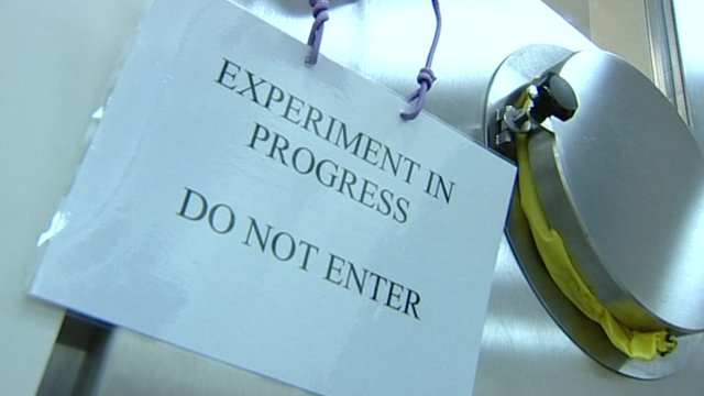 Sign reading 'Experiment in progress, do not enter'