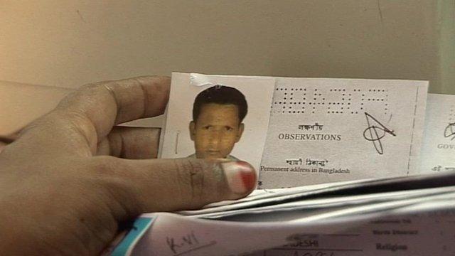 A man sifts through Bangladesh employment records