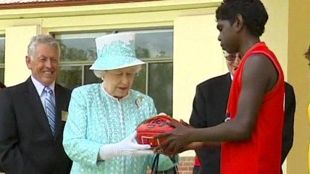 Queen receives Aussie rules football