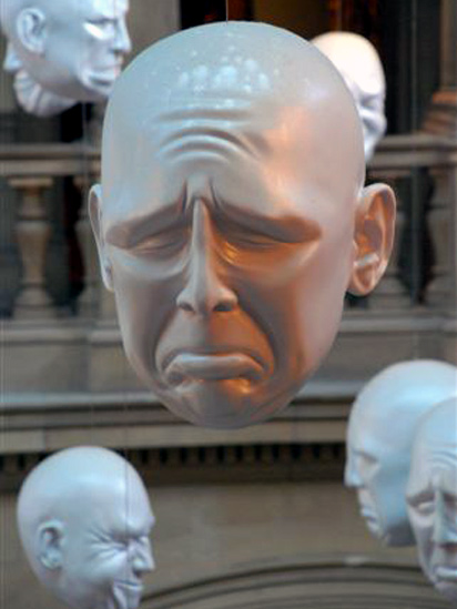 Suspended artificial faces in Kelvingrove Art Gallery and Museum