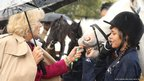 Camilla, Duchess of Cornwall, meets young riders during her visit to open Ebony Horse Club in Brixton, south London