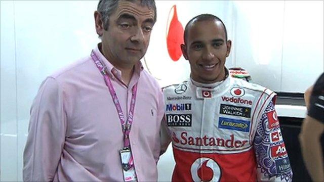 Rowan Atkinson with Lewis Hamilton