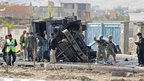Destroyed vehicle at scene of suicide bomb attack in Kabul