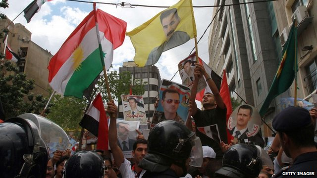 Pro-Assad crowds in Syria