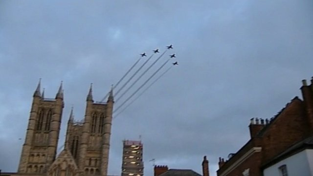 Five Red Arrows in formation above Lincoln cathedral