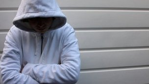 A teenager wearing a hooded top