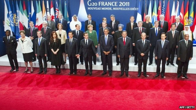 World leaders pose for a family photo during the G20 Summit in Cannes