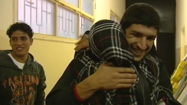 Man hugging woman after being released from prison