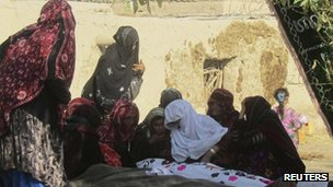 Afghan women mourn civilians killed by a suicide attack in Baghlan province on 6 November 2011
