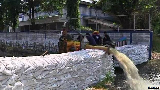 Flood water is pumped in Bangkok