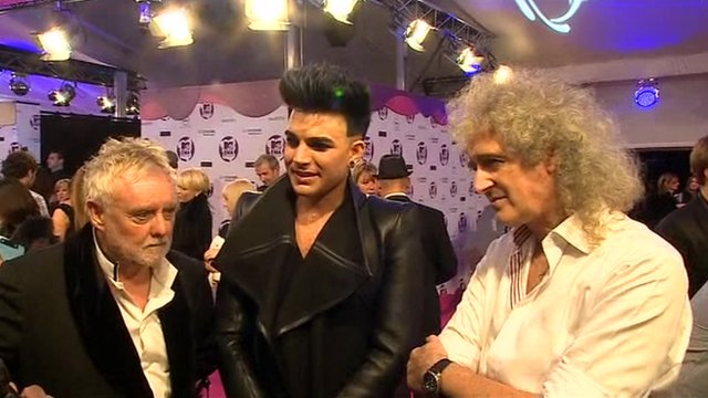 Roger Taylor (L), Adam Lambert (C), and Brian May (R)