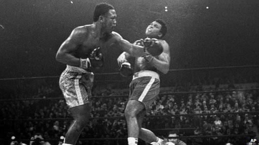 Joe Frazier hits Muhammad Ali with a left during the 15th round of their heavyweight title fight