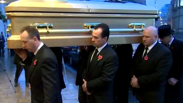Sir Jimmy Savile's coffin is carried into the hotel in Leeds