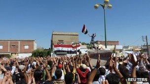 Demonstrators protesting against Syria's President Bashar al-Assad gather in Hula, near Homs, 4 November 2011