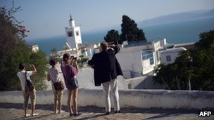 Tourists in Sidi Bou Said, Syria, last month