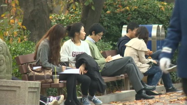 Students seated on a bench