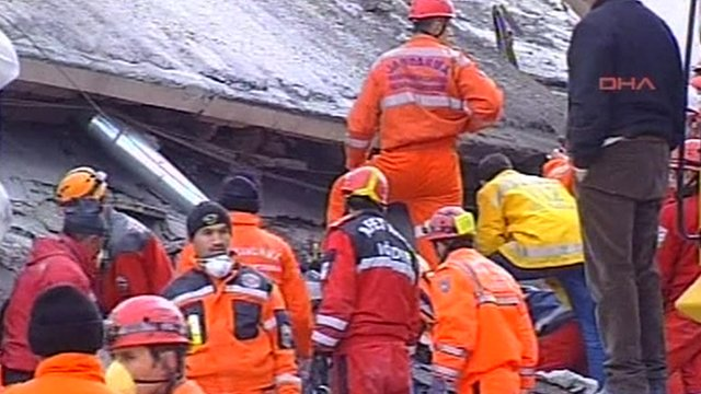 Rescuers on rubble