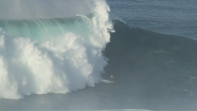 Garret McNamara riding wave