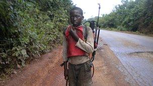 Child labourer with pesticide equipment